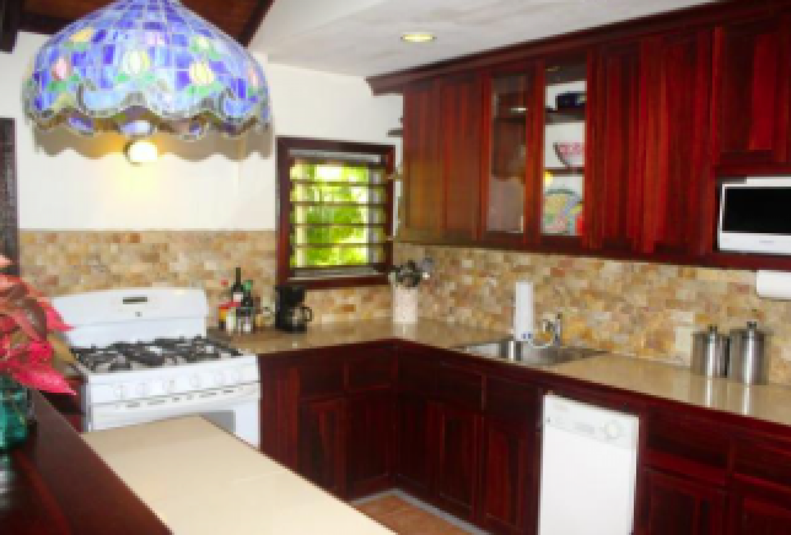 Open plan fully equipped kitchen, comfortable lounge and separate dining area.