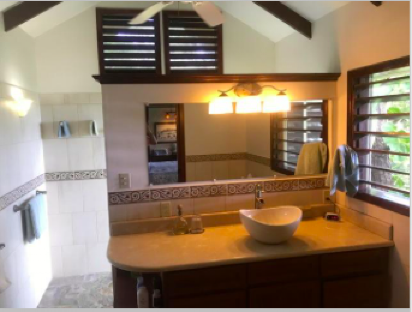 Spacious bathroom with great views and ventilation.