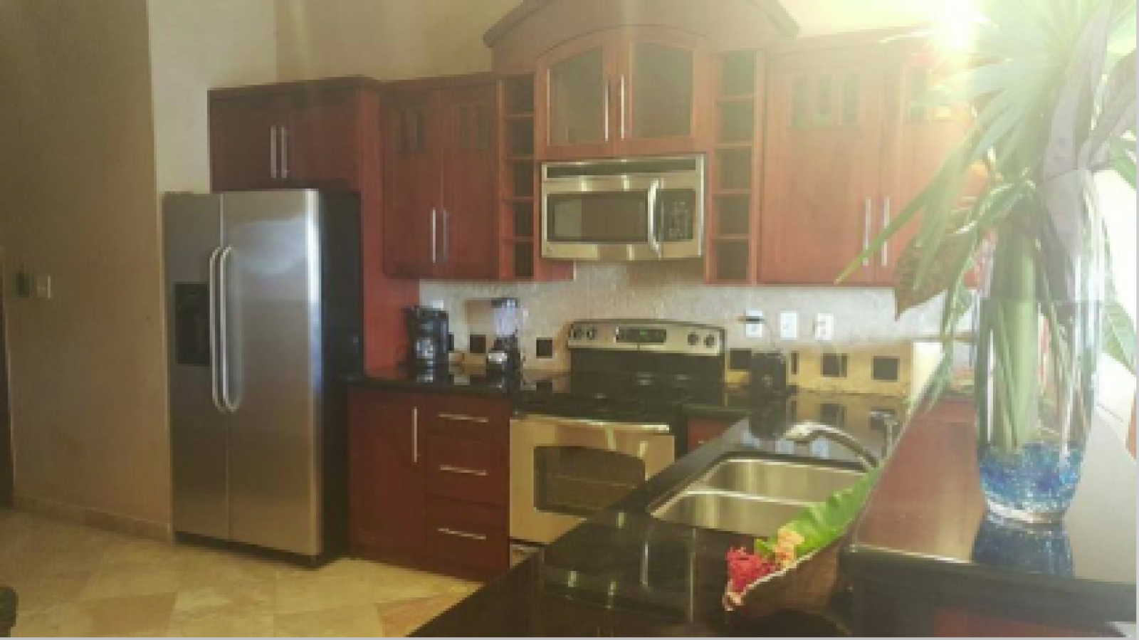 Granite countertops, high end appliances and fully equipped kitchen.
