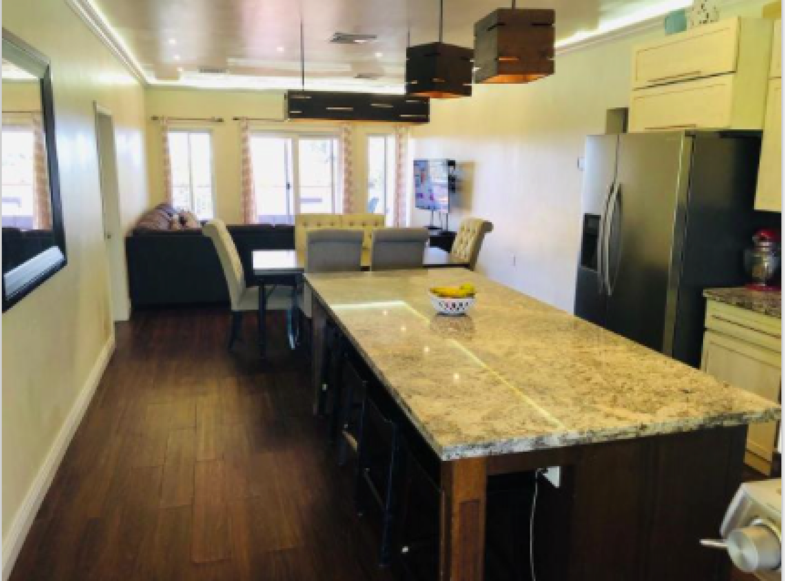 Granite countertops in a fully equipped kitchen.