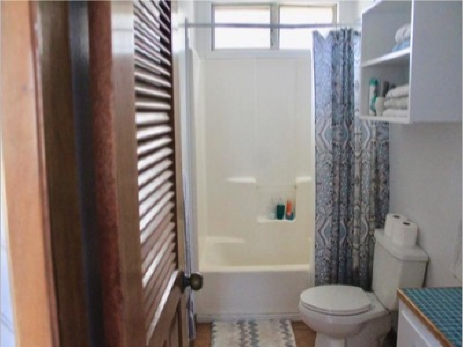 A functional bathroom with storage, light and space.