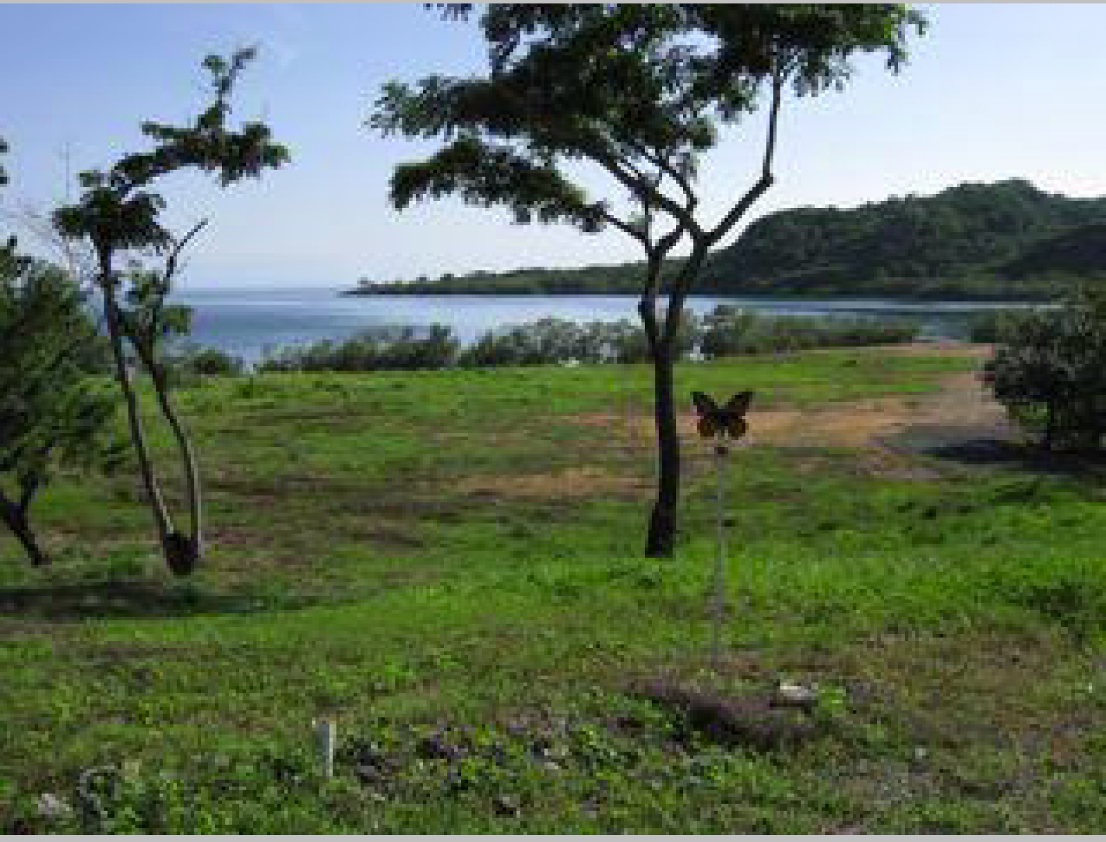 Flat, buildable lot overlooking the water